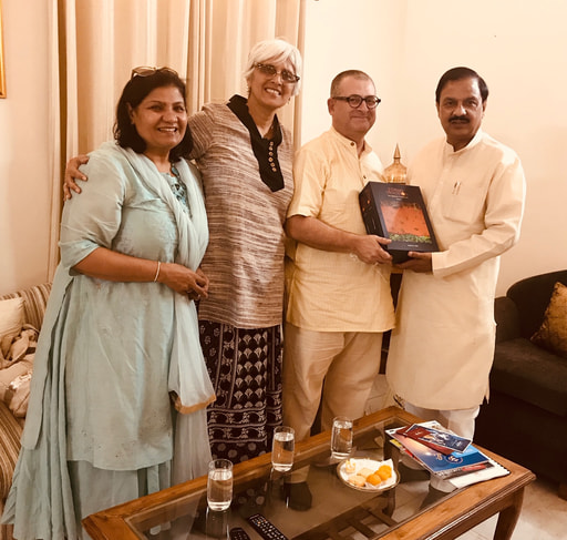 Mahaprabhu dasa giving Forms of Devotion book to Minister of Culture of India