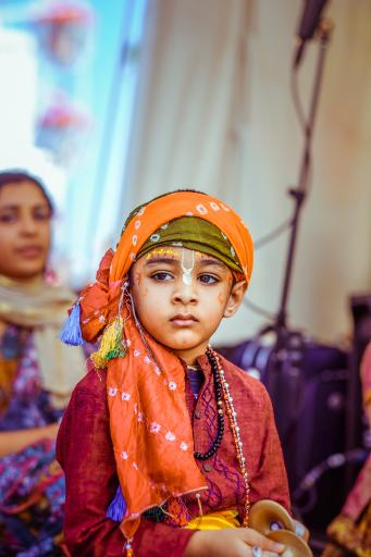 A child dressed up for a festival play performance