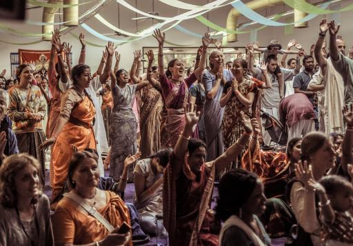 Devotees dancing at a festival