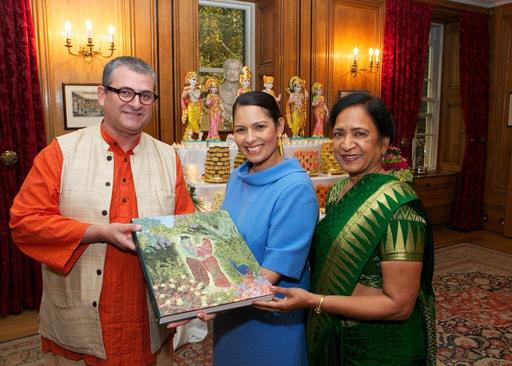 Mahaprabhu dasa giving a copy of the Ramayana to Priti Patel during Diwali Reception at 10 Downing St.